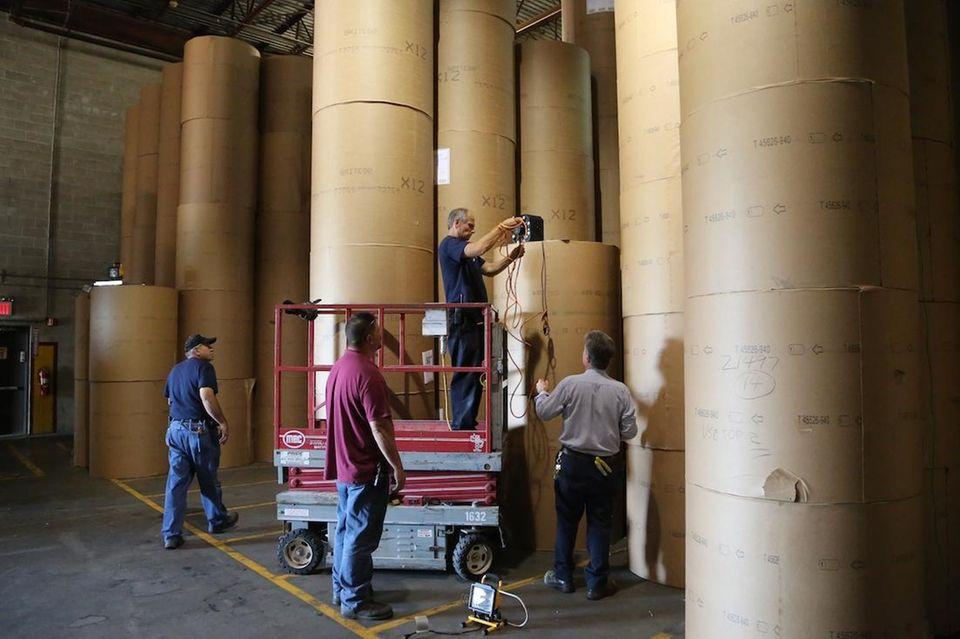 Newsday staff set up lighting before filming Battle