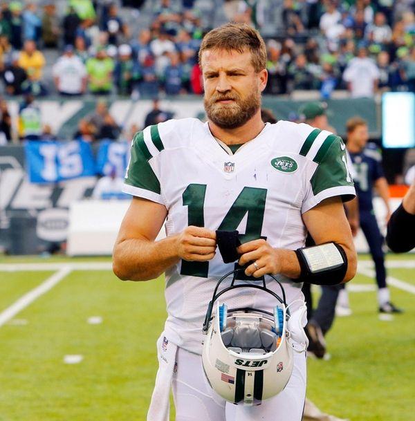 Ryan Fitzpatrick of the New York Jets walks