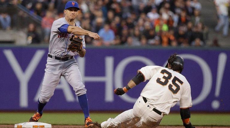 New York Mets second baseman T.J. Rivera turns