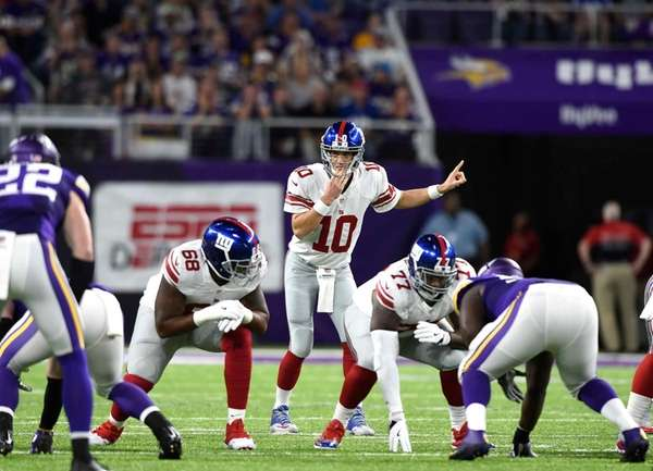 Eli Manning of the New York Giants directs