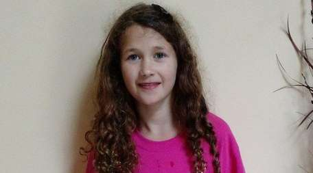 Nikolina Johannessen, 9, of Lake Grove, helps raise