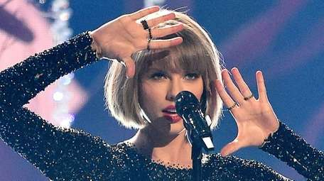 Taylor Swift performs during the 58th Grammy Awards