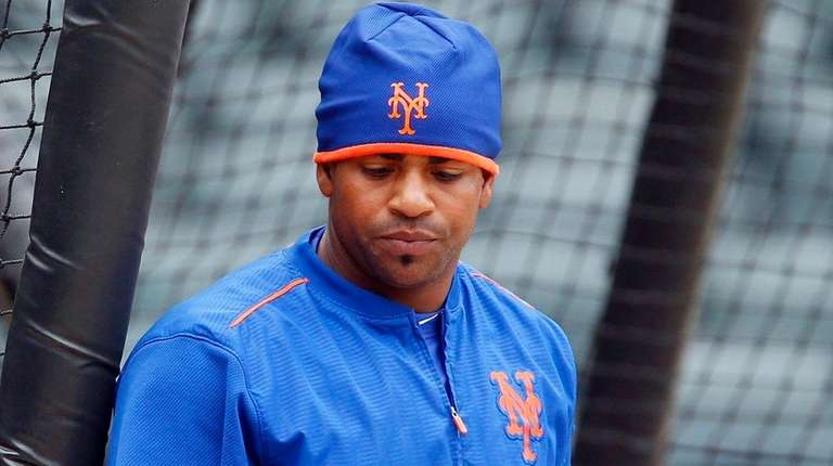 Yoenis Cespedes inspects his bat at batting practice