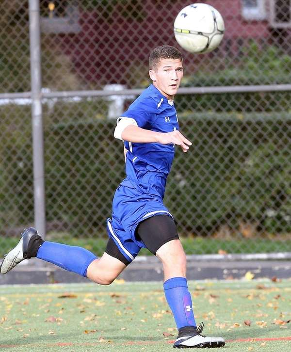 Kellenberg's Ray Minewiser plays the ball against St.