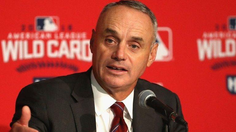 Major League Baseball Commissioner Rob Manfred addresses the