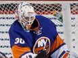 New York Islanders goalie Jean-Francois Berube (30) makes