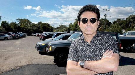 Francesco Regini, of Brooklyn, stands in a parking
