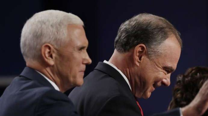Mike Pence, left, and Tim Kaine, leave the