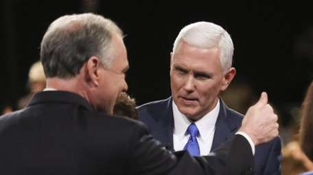 Tim Kaine, left, Mike Pence appear after the