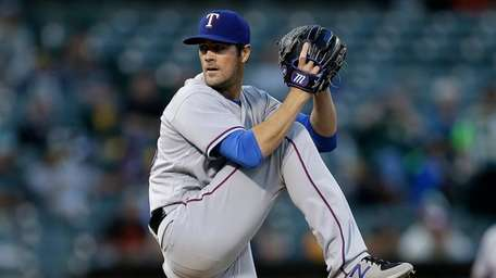 Texas Rangers pitcher Cole Hamels works against the