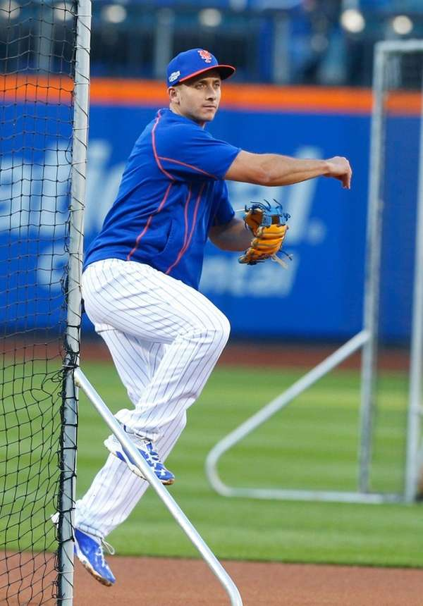 New York Mets second baseman T.J. Rivera looks