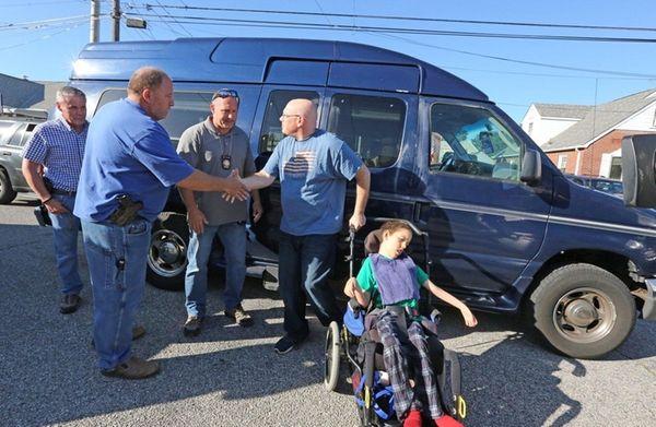 Rob Gasperetti, right, thanks Nassau County detectives on