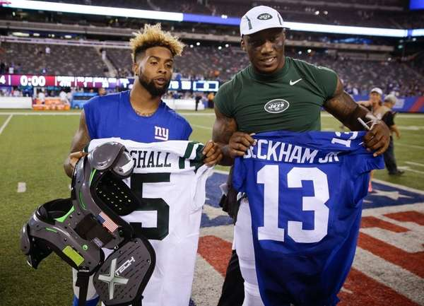Giants wide receiver Odell Beckham, left, and Jets