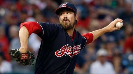 Cleveland Indians relief pitcher Andrew Miller delivers against