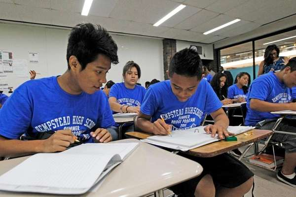From left, Irvir Reyes, Axel Sanchez and classmates