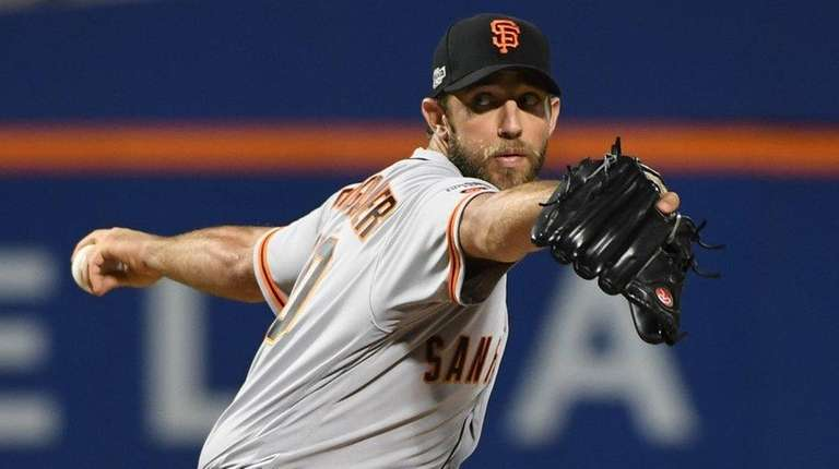 San Francisco Giants' Madison Bumgarner delivers a pitch