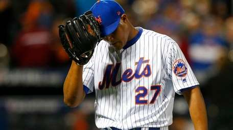 Jeurys Familia walks off the mound after giving