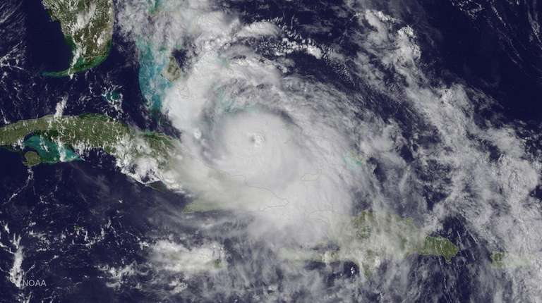 A satellite image shows Hurricane Matthew as it
