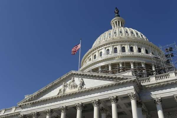 An American flag flies over Capitol Hill in