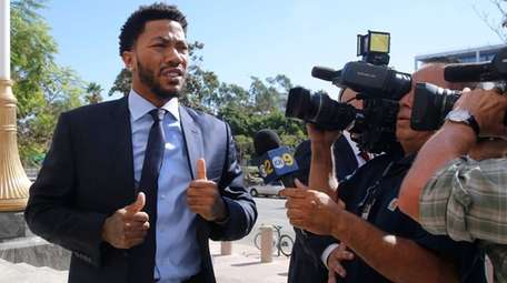 New York Knicks basketball player Derrick Rose arrives