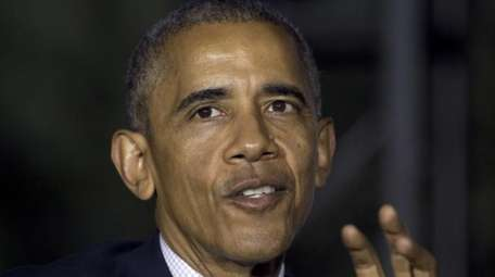 President Barack Obama talks on the South Lawn
