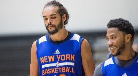 New York Knicks' Joakim Noah and Derrick Rose