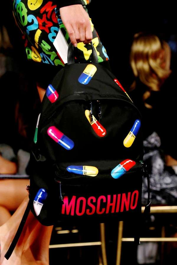 A model with a Moschino bag is seen