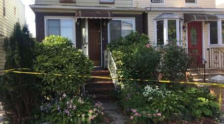 Police tape surrounds a house, left, where officers