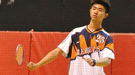 Ethan Wu of Great Neck South returns a