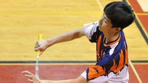 Ray Ngan of Great Neck South serves during