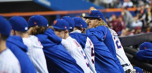 New York Mets starting pitcher Noah Syndergaard looks