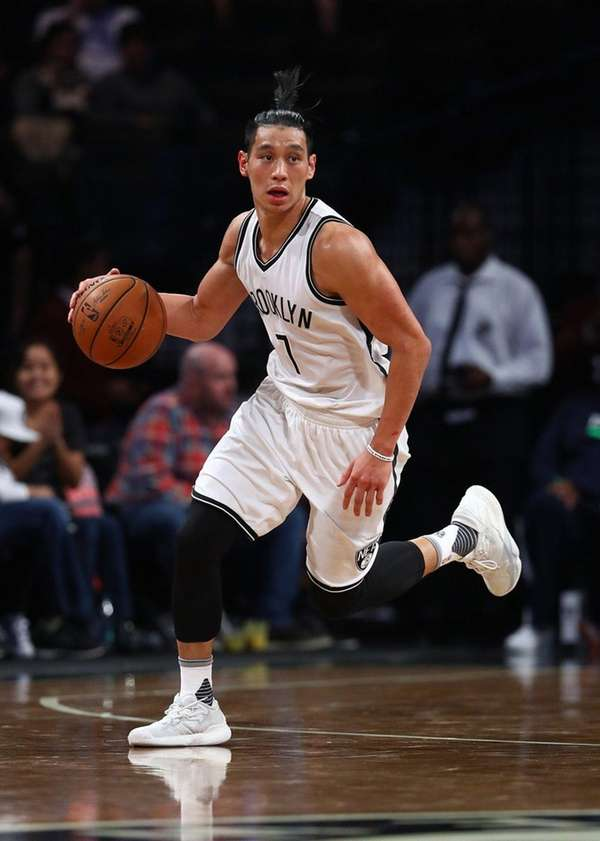 Jeremy Lin of the Brooklyn Nets dribbles the