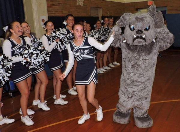 The George W. Hewlett High School cheerleaders escort