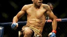 Jose Aldo celebrates after beating Cub Swanson in