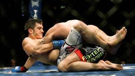 Josh Grispi, left, chokes Jens Pulver in the