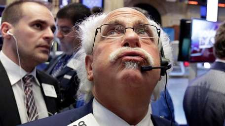 Trader Peter Tuchman exhales he watches the numbers