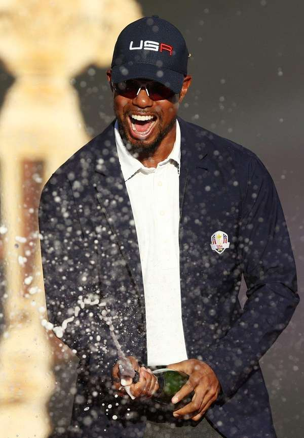 Vice-captain Tiger Woods of the United States celebrates