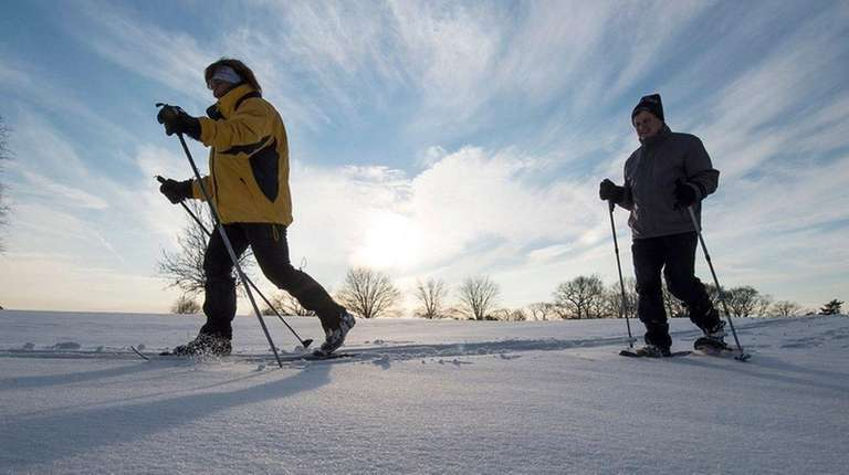 Trekking across the snow in Bethpage State Park