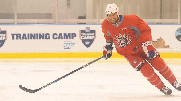 Tanner Glass of the New York Rangers skates