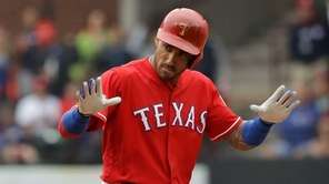 Ian Desmond #20 of the Texas Rangers reacts