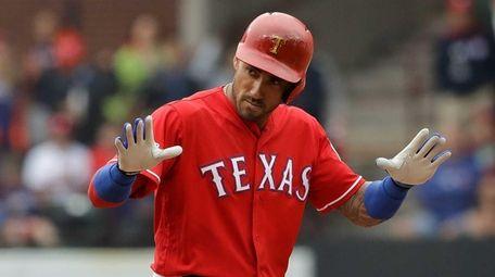 Ian Desmond #20 of the Texas Rangers reacts