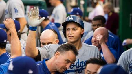 Los Angeles Dodgers' shortstop Corey Seager is congratulated