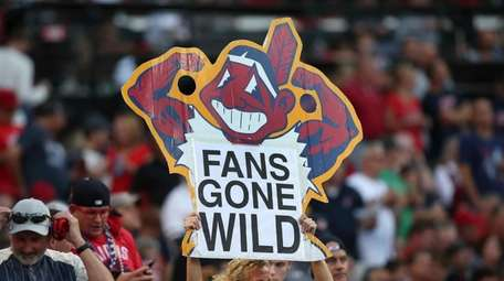 A Cleveland Indians fan holds a sign during