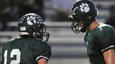 Lindenhurst's Jeremy Ruckert, right, gets congratulated by teammate