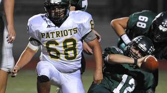 Stephen Torrico of Ward Melville, left, gets to
