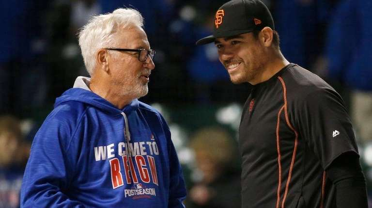 Chicago Cubs' manager Joe Maddon talks to San
