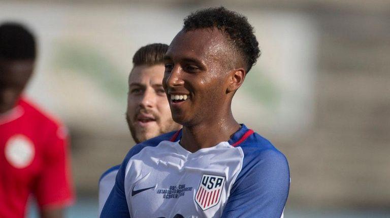 Julian Green, of the U.S., celebrates scoring the