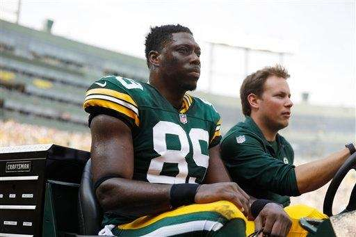 Green Bay Packers' Jared Cook is carted off