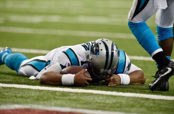 Carolina Panthers' quarterback Cam Newton lies on the