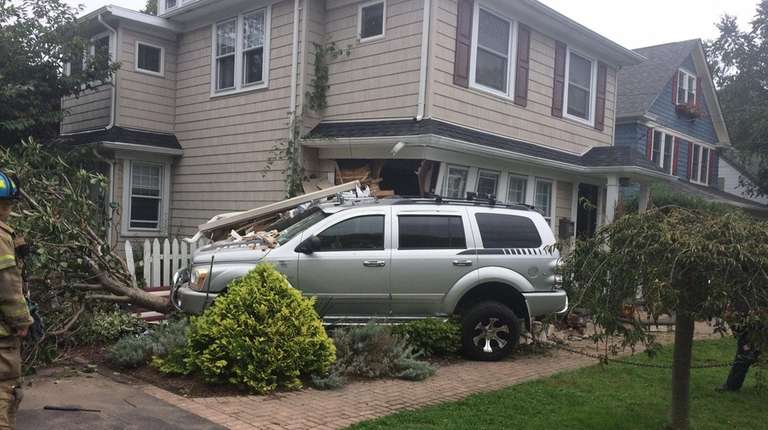 Suffolk police said an SUV hit a house